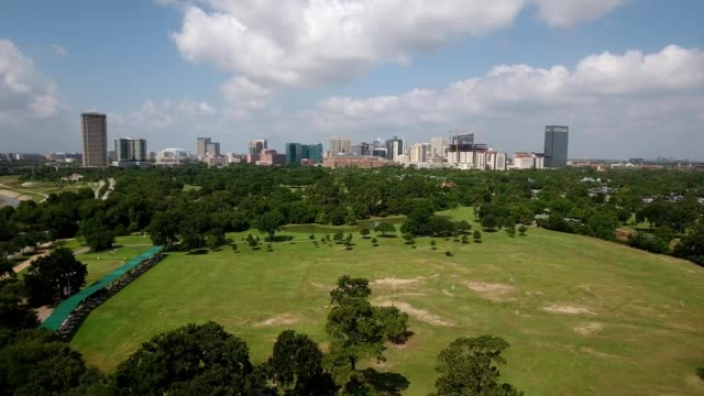 a drone flies over a driving golf range in houston texas - medical building stock videos & royalty-free footage