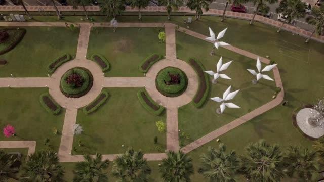 a drone flies over a fountain garden in johor bahru malaysia - johor stock videos & royalty-free footage