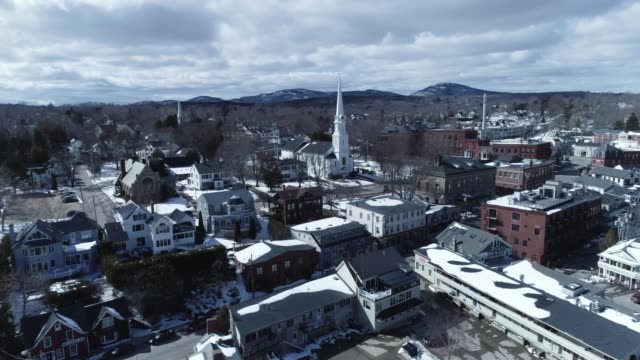 a drone flies over a harbor church in snowy camden maine - maine stock videos & royalty-free footage