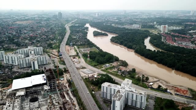 a drone flies over a highway in johor bahru malaysia - johor stock videos & royalty-free footage