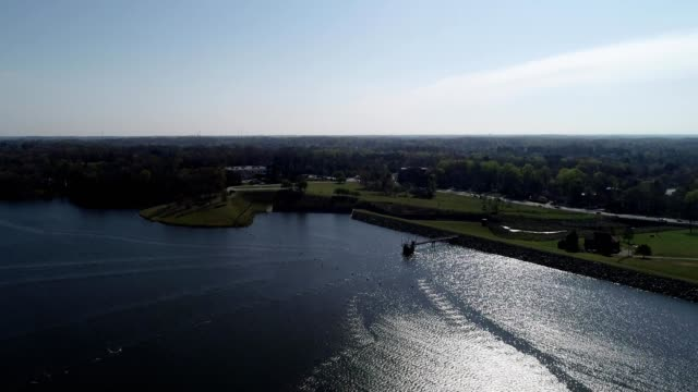 a drone flies over a lake in high point north carolina - high point video stock e b–roll