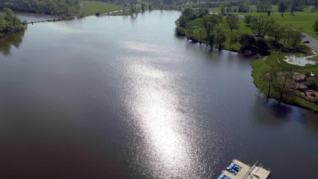 a drone flies over a lake in lexington kentucky - kentucky stock videos & royalty-free footage