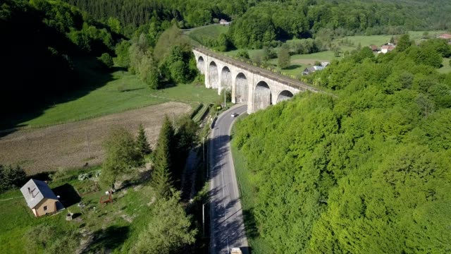 a drone flies over a railway bridge of teliu in prejmer brașov county romania - transylvania stock videos & royalty-free footage