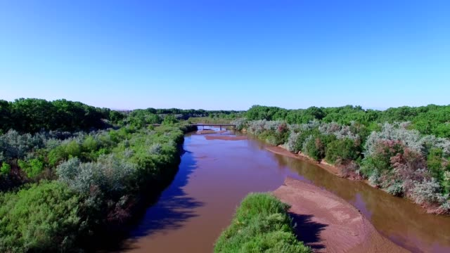 a drone flies over a river in belen new mexico - new mexico stock videos & royalty-free footage