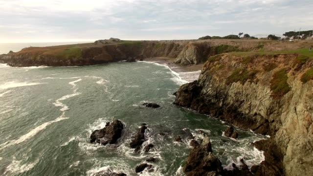 a drone flies over a rocky coast and beach in jenner california - dronebase stock videos and b-roll footage