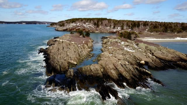 a drone flies over a rocky coast in phippsburg maine - dronebase stock videos and b-roll footage