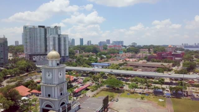 a drone flies over a skyscraper in johor bahru city malaysia - マレーシア点の映像素材/bロール