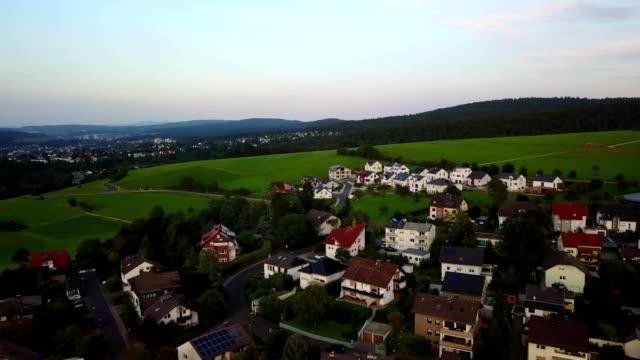 a drone flies over a small german village in wiesbaden hesse germany - wiesbaden stock-videos und b-roll-filmmaterial