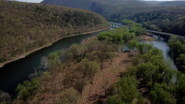 a drone flies over a stream in the poconos of delaware water gap pennsylvania - dronebase stock videos and b-roll footage