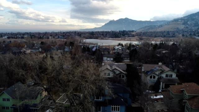 a drone flies over a suburban neighborhood in boulder colorado - boulder stock videos & royalty-free footage