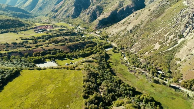 a drone flies over a valley in big springs park in provo utah - provo stock videos & royalty-free footage