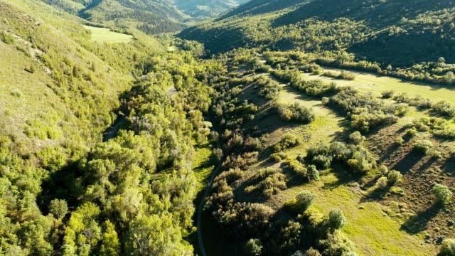 stockvideo's en b-roll-footage met a drone flies over a valley in big springs park in provo utah - provo