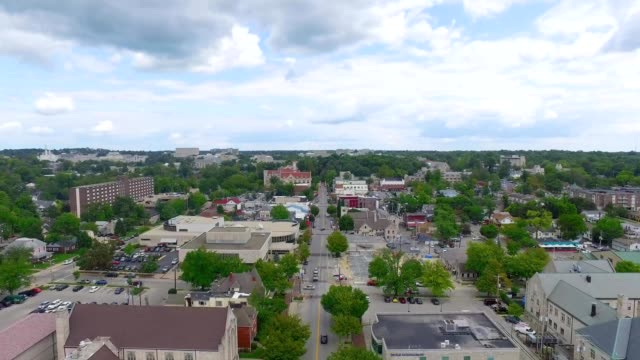 a drone flies over bloomington indiana - indiana stock videos & royalty-free footage