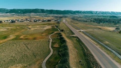 stockvideo's en b-roll-footage met a drone flies over casper mountain road in casper wyoming - wyoming