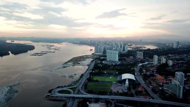 a drone flies over danga bay at sunset in johor bahru malaysia - johor stock videos & royalty-free footage