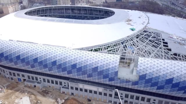 vidéos et rushes de a drone flies over dinamo stadium during restoration for the 2018 football world championship in moscow russia - fédération de russie