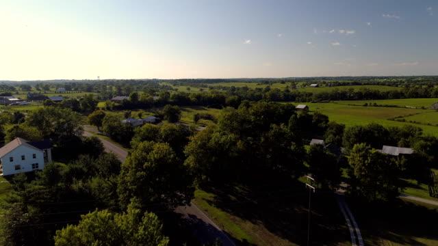 a drone flies over farmland in cynthiana kentucky - kentucky stock videos and b-roll footage