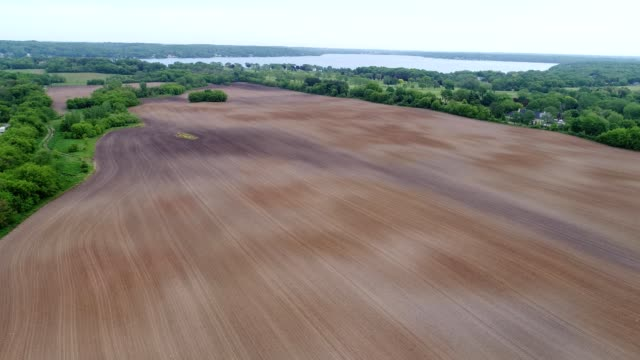 a drone flies over fresh spring fields in lake geneva wisconsin - lake geneva stock videos & royalty-free footage