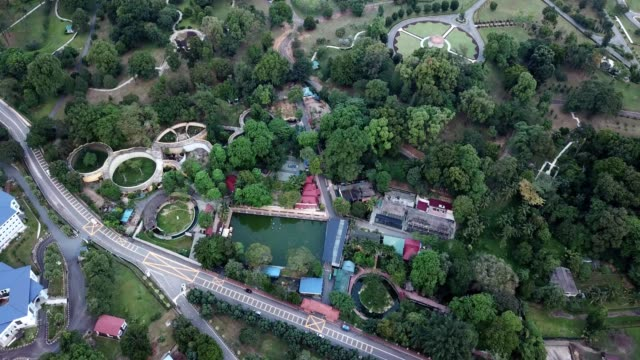 a drone flies over johor bahru zoo in malaysia - zoo stock videos & royalty-free footage