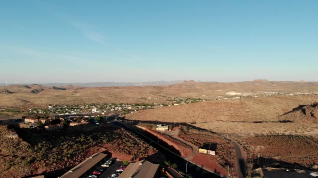 a drone flies over kingman arizona with wind turbines in the background - kingman arizona stock videos & royalty-free footage