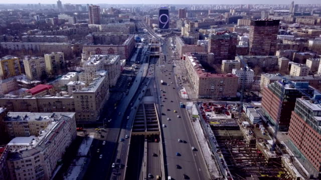 a drone flies over leningradskiy avenue in moscow russia - モスクワ市点の映像素材/bロール