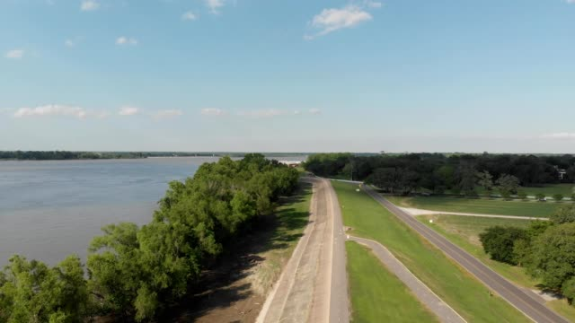 A drone flies over levee road along the Mississippi River in Vacherie Louisiana