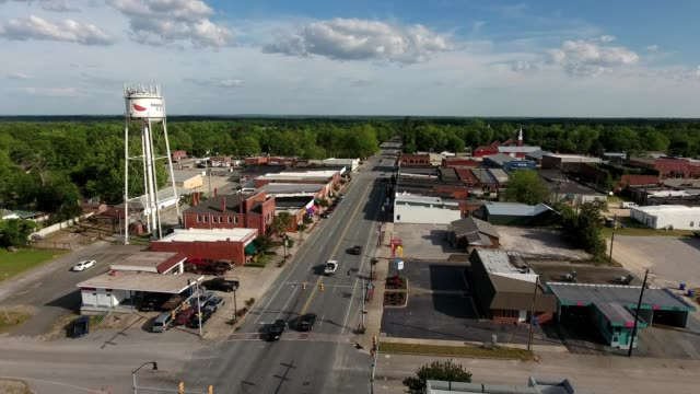 a drone flies over pageland south carolina - small town stock videos & royalty-free footage