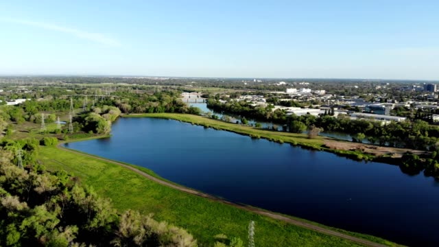 a drone flies over the american river in sacramento california - sacramento stock videos & royalty-free footage