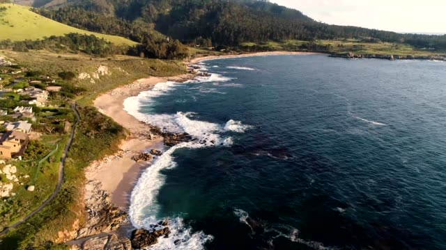 a drone flies over the coast of monterey bay beaches in carmel-by-the-sea california - carmel california stock videos and b-roll footage