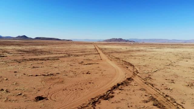 a drone flies over the desert in kingman arizona - kingman arizona stock videos & royalty-free footage