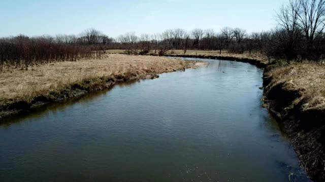 a drone flies over the dupage river in naperville illinois - dronebase stock videos and b-roll footage
