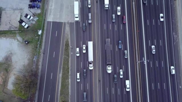 a drone flies over the highways meeting up heading towards atlanta georgia - atlanta stock videos and b-roll footage