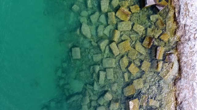 a drone flies over the shore line of the lake michigan in chicago illinois - lake michigan stock videos & royalty-free footage