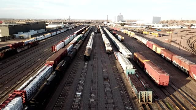 a drone flies over tracks in a train yard in denver colorado - shunting yard stock videos and b-roll footage