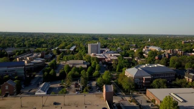 a drone flies over uncg campus in greensboro north carolina - campus stock videos & royalty-free footage
