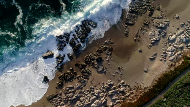 a drone flies over waves on the shores of carmel-by-the-sea california - carmel california stock videos and b-roll footage