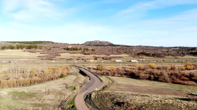 A drone flies over wetlands by an interstate in Castle Rock Colorado