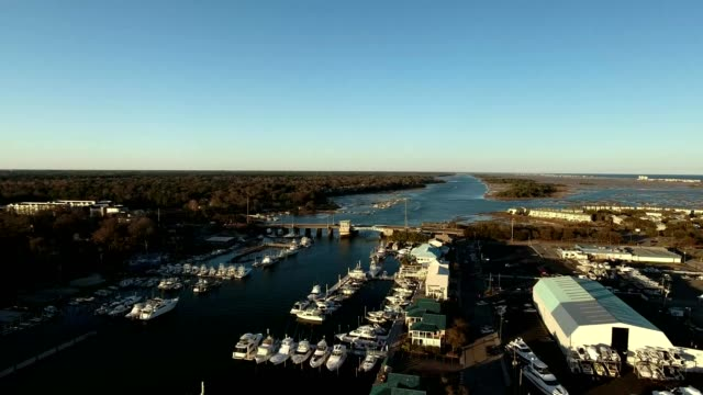 a drone flies over wrightsville beach bridge over the intracoastal waterway in north carolina - carolina beach stock videos & royalty-free footage