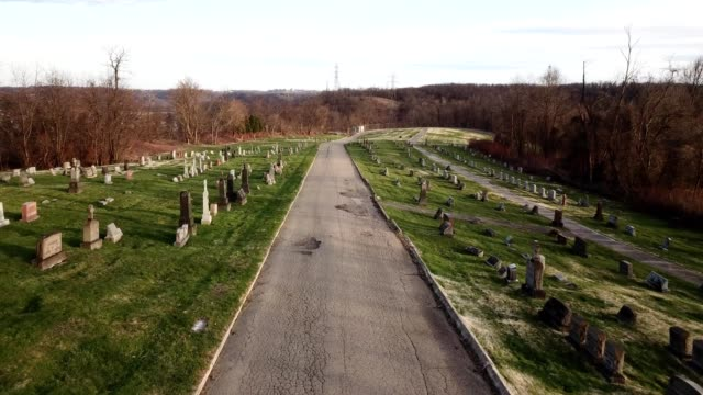 a drone flies through a cemetery in pittsburgh pennsylvania - cemetery stock videos & royalty-free footage