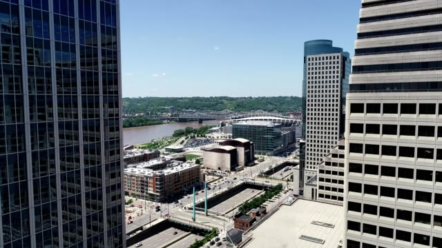 A drone flies through buildings in downtown Cincinnati Ohio