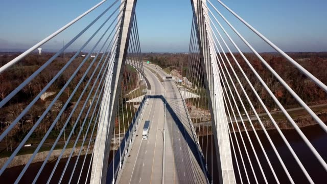 a drone flies through the lewis and clark bridge in louisville kentucky - kentucky stock videos & royalty-free footage