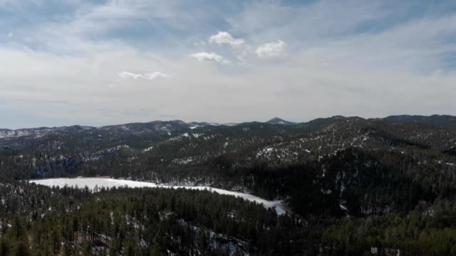a drone flies towads center lake in custer state park south dakota - custer state park stock videos & royalty-free footage