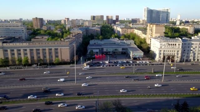 "A drone flies toward the commercial center ""Aeroport Gallery"" near metro stop Aeroport, crossing Leningradskiy Prospect."