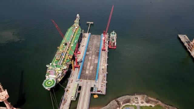 a drone flies towards a docked oil tanker in pasir gudang johor malaysia - johor stock videos & royalty-free footage
