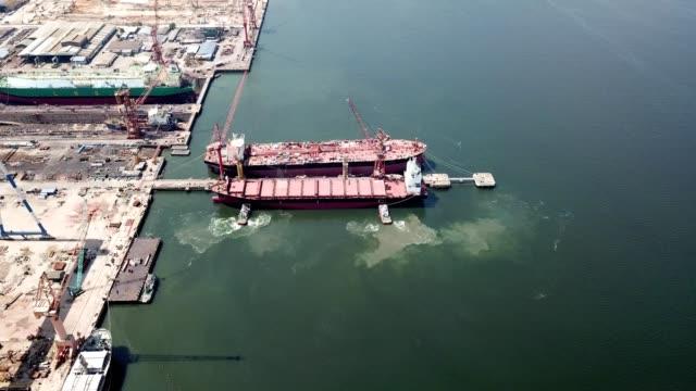 a drone flies towards a docked ship in pasir gudang johor malaysia - johor stock videos & royalty-free footage