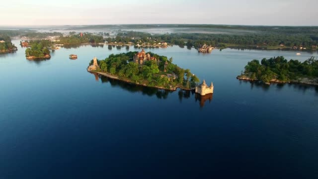 A Drone flies towards Boldt Castle in the Thousand Islands on the St. Lawrence River in Alexandria Bay New York