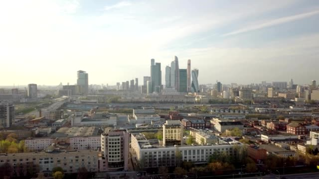 a drone flies towards moscow city in moscow russia - moskau stock-videos und b-roll-filmmaterial