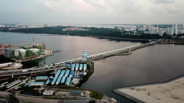 a drone flies towards the causeway bridge in johor bahru malaysia - johor stock videos & royalty-free footage
