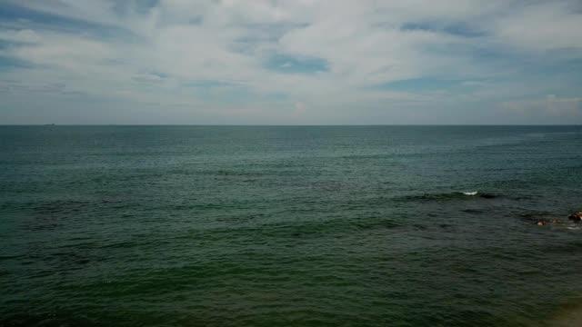 a drone flies towards the ocean off the coast of desaru beach in kota tinggi johor malaysia - johor stock videos & royalty-free footage
