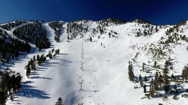 a drone flies up slide mountain ski resort near lake tahoe in reno nevada - dronebase stock videos & royalty-free footage